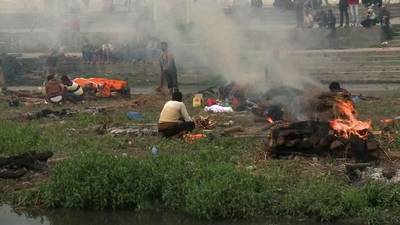News video: Mass cremation held for victims of N